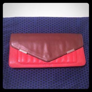 Rebecca Minkoff leather clutch in orange and brown